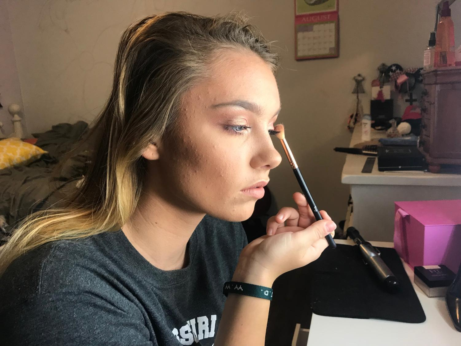 "Applying eye shadow, senior Bailey Goughenour completes a makeup look. Goughenour started her makeup Instagram and YouTube accounts this summer in order to further her hobby and do more freelance makeup. ""As of right now, I'd say my Instagram account is what I'm most proud of because I put a lot of effort into it, and it's really satisfying to see people following me, commenting or direct messaging me asking if I can do their makeup,"" Goughenour said."
