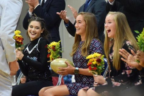"Receiving the golden football, senior Chloe Hershenow is crowned Homecoming Queen alongside the maids on the 2018 Homecoming Court. This was Hershenow's first time as a maid. ""It was really sweet because everyone was cheering and really happy for me and I was kind of in shock,"" Hershenow said. ""It was really humbling too because it felt really odd to me to be chosen by my classmates [for Homecoming Queen.]"""