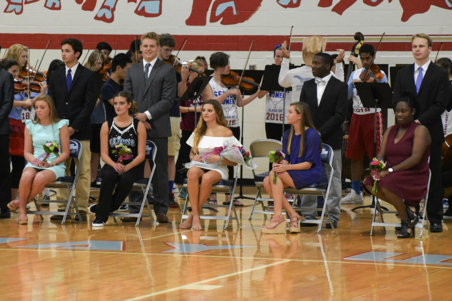 Waiting for the announcement of the Homecoming Queen, the 2017 Homecoming court sits in the gym during the fall pep rally.