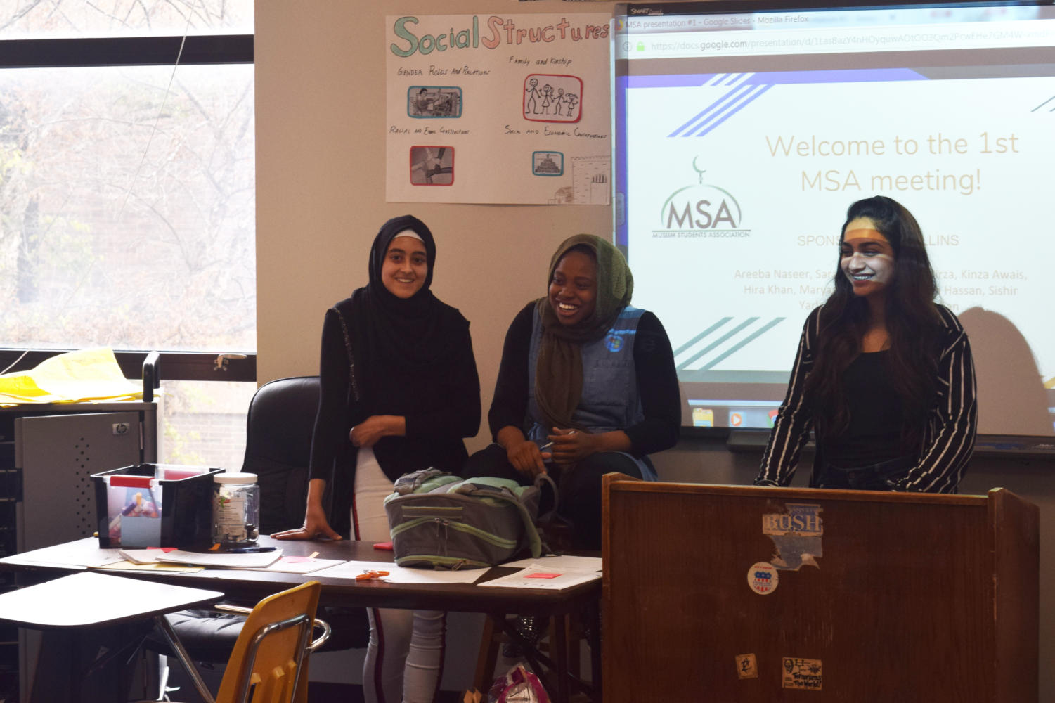"Seniors Maryam Oyebamiji, Kinza Awais and junior Mariam Mirza introduce themselves to members at the first Muslim Student Association meeting. Meetings are held on the first and third Wednesdays of the month. ""I felt like their needed to be a safe haven for a lot muslims because their facing a lot of backlash especially in this day and age,"" Awais said. ""A lot of schools have it, and I felt like West needed to have one because we have a big Muslim student population."""