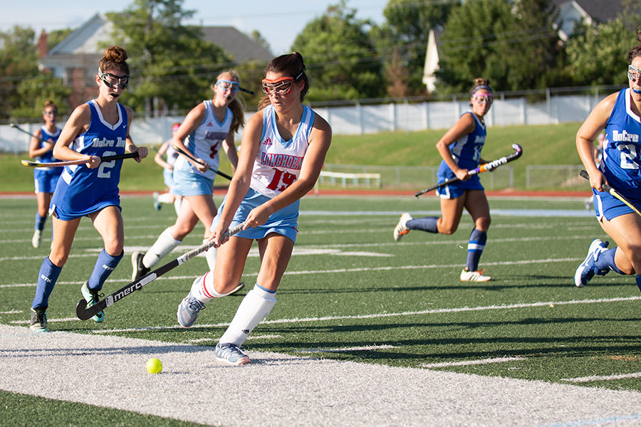 "In a varsity game against Notre Dame High School, senior forward Olivia Riemer runs the ball down the sideline. The team is preparing for the post season tournament beginning Oct. 22, where they hope to finish among the top 16 teams in the state, something they have never accomplished. ""We are working in practice on playing with more intensity and having good transfers as we get ready for the end of the season,"" Riemer said."
