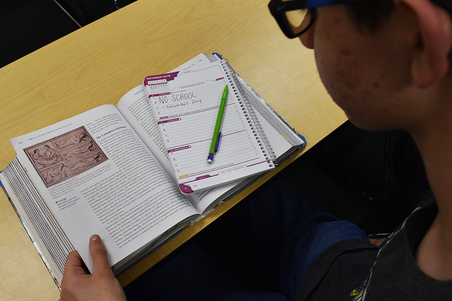 A student looks at his planner, which indicates that there is no school on Columbus Day. Despite the fact that Columbus brought mostly harm to Indigenous people, many schools still get off school to celebrate his legacy.