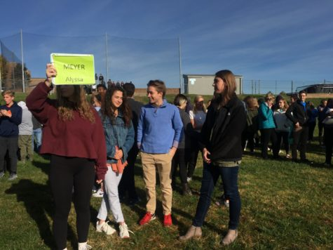 Students stand in the field behind the school during a fire drill Oct. 24 after taking an hour of the day to practice emergency drills. This day of practice followed a real fire alarm Oct. 23.