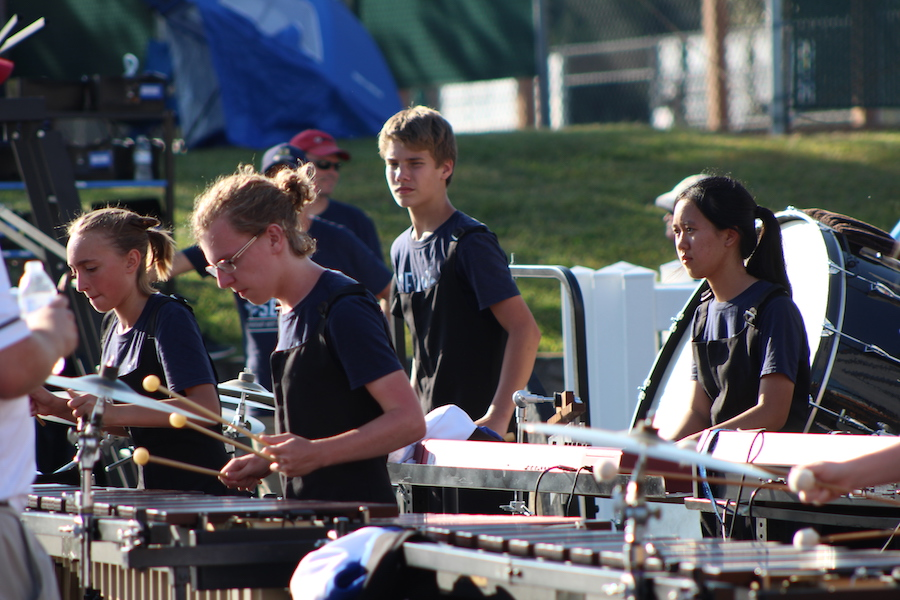 Junior Aim Achalapong plays synthesizer at the Edwardsville Tiger Ambush Classic Marching Band Festival. Achalapong learned to play piano in Thailand and decided to join the marching band for the year she was here.
