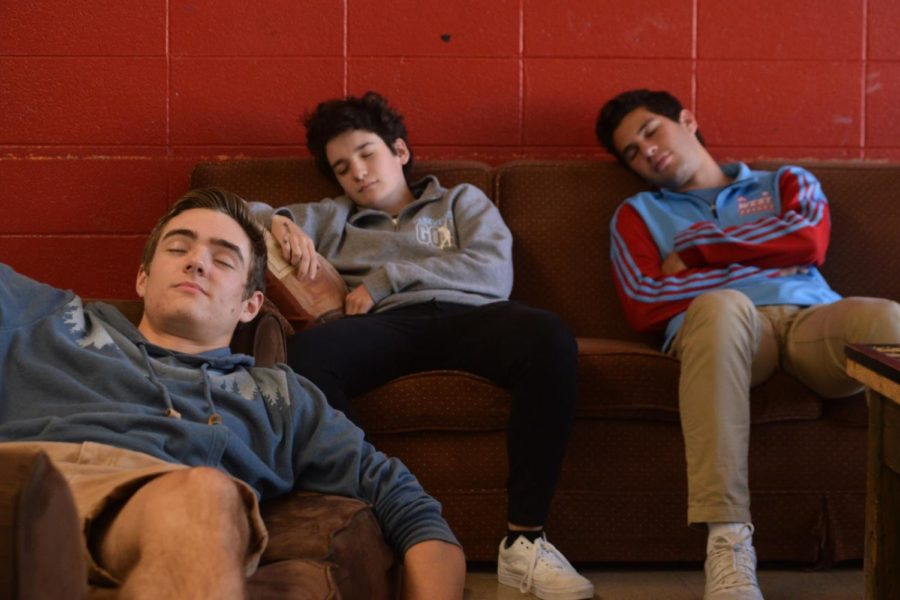 """Seniors Peyton Gaskill, Dani Fischer and Zach Poscover take a much-needed snooze in the senior lounge. The senior lounge exists so that seniors can sleep during the school day. """"My favorite part of senior year is staying up late so I can sleep at school,"""" Fischer said. """"School is so fun."""""""