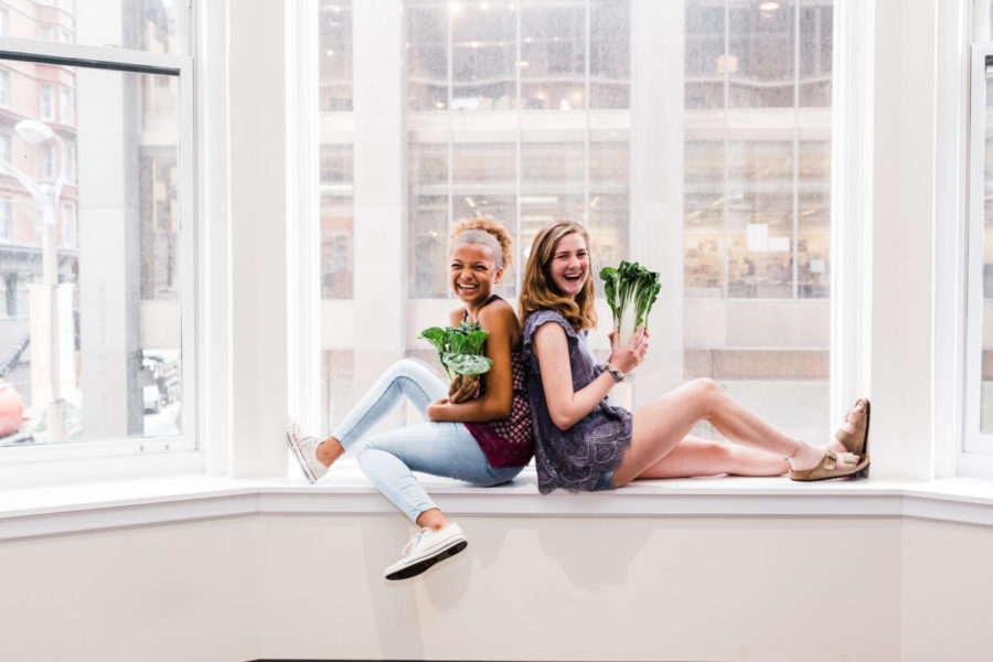 "Posing with a bok choy, Webster Groves freshman Bree Tokraks and sophomore Kathryn McAuliffe relish in their inside jokes from Kode with Klossy, a free two-week summer camp designed to empower teen girls interested in coding. McAuliffe discovered the program through Peerlift, an organization that strives to help prepare high school students for the future. ""I'd like to do Kode with Klossy next year, and I will apply for sure, but there are a couple of other opportunities I'm more interested in. I don't even know what those opportunities might be, but I'd like to do something more in my interests with journalism or activism,"" McAuliffe said."