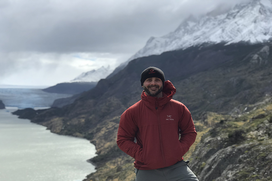 "On his trek at Torres Del Paine National Park in Chile, alumnus Eddie Kampelman takes a break to capture a positive memento of his own. ""I never felt like I was wasting my time or money on such a life changing experience,"" Kampelman said. ""Certainly I've learned the most from 'underdeveloped' countries. Most of the people are very creative and hardworking and have a very positive attitudes despite not having a lot of things. [It serves as] a great reminder that happiness doesn't come from material objects."""