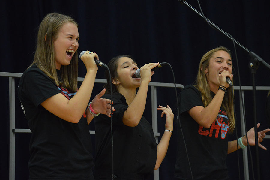 "Senior Meghan Stanfield, junior Theresa Monteleone and senior Chloe Hershenow perform enthusiastically in Jazz Choir at the First Annual Music Department Showcase Concert. This is Stanfield's second year in the ensemble. ""Singing is my passion, and it's so nice to come to class to just sing with all my friends,"" Stanfield said. ""It really helps me forget about all the chaos of the world."""