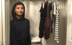 Sophomore Ayesha Malik poses in front of her wardrobe, containing only 10 items. Malik adopted the fashion minimalist lifestyle 1 year ago.