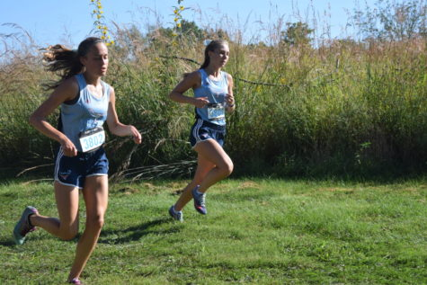 Pacing together, sophomores Leach Selm and Emily Sipp compete at the Paul Enke Invitational at Sioux Passage Sept. 15. Sipp and Selm have both qualified to compete with the state team.