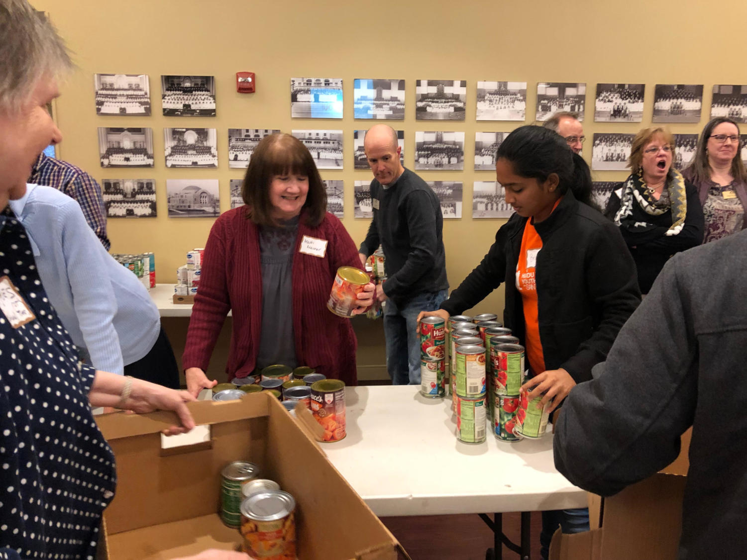 """Sorting through canned goods Nov. 19, freshman Brinda Ambal participates in the West County Interfaith Alliance Thanksgiving drive. Members from the Hindu, Islamic and Jewish temples came together alongside Catholic and Christian church members to better understand each other's faith and provide canned food for the Parkway Food Pantry. """"In a world where there is so much religious conflict, it is really great to see people come together,"""" Ambal said."""
