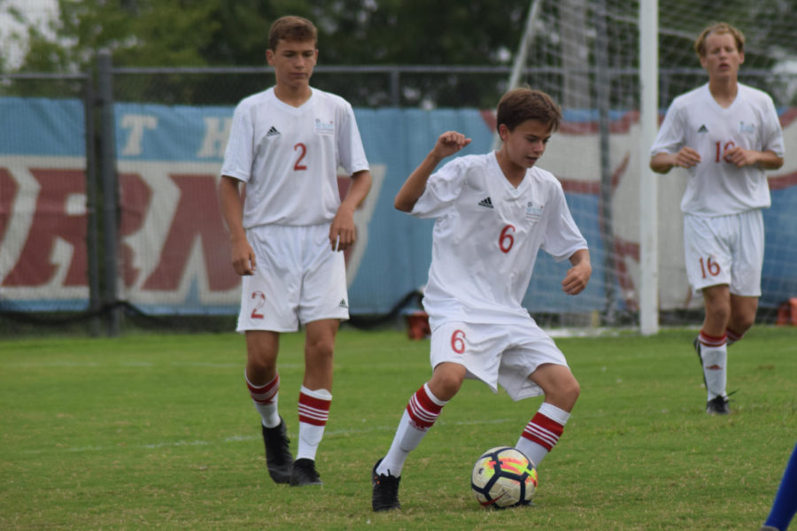 Cutting+around+an+opponent%2C+freshman+Ethan+Geiger+dribbles+the+ball+down+the+field.+Geiger+and+the+C-team+were+the+first+C-team+in+boys+soccer+history+to+have+a+winning+record.+%22The+team+always+worked+really+hard+at+practices+and+in+games%2C%22+Geiger.+%22We+got+fourth+in+the+tournament+which+was+really+cool%2C+because+we+have+a+good+team+chemistry+and+are+always+just+joking+around+with+each+other+and+just+enjoy+playing+soccer.%22