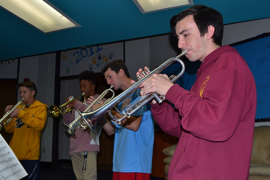 "Focused on his music, senior Noah Wright plays his trumpet alongside the rest of trumpet section during his second hour class. Wright has been playing in the Jazz Band since his sophomore year, but this is his first year playing with a full instrumentation.""With there being more people, we've really been able to push ourselves,"" Wright said. ""We really have depth in the parts."""