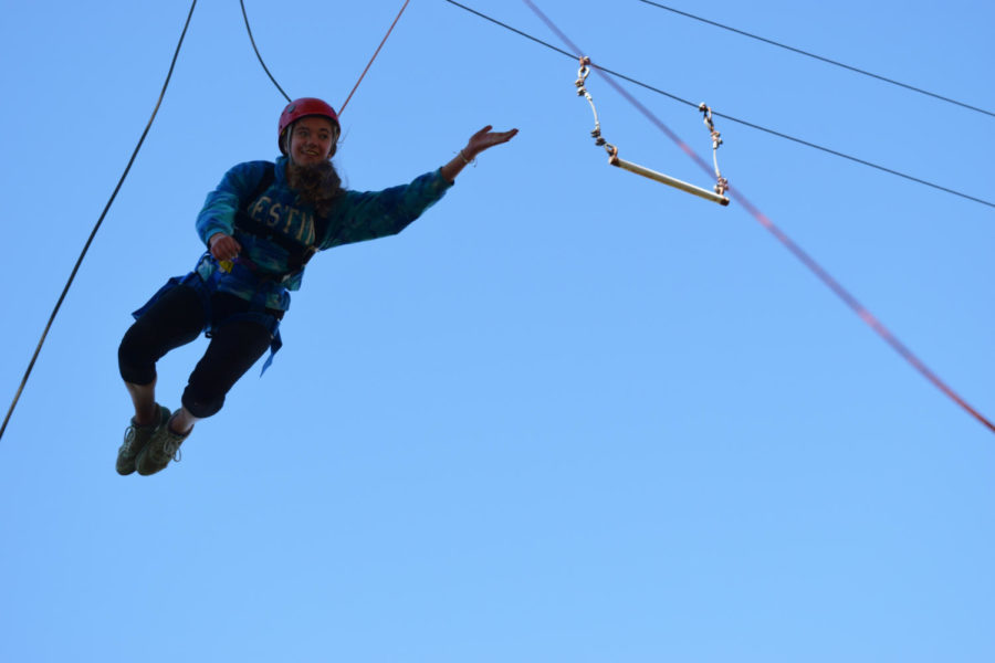 Soaring+through+the+air%2C+sophomore+Sarenna+Wood+takes+on+the+Parkway+North+ropes+course%2C+part+of+the+Adventure+Pursuit+field+trip+Oct.+29.+The+students+jumped+off+tall+platforms+and+attempted+to+grab+trapeze+bars.+%E2%80%9CIt+was+terrifying+actually%2C+getting+on+top+of+it+was+the+hardest+part%2C+it+was+all+adrenaline+and+you+didn%27t+feel+anything+else%2C%E2%80%9D+Wood+said.