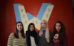 "Staring ahead, sophomores Camila Angulo, senior Hira Khan, sophomore Ulaa Kuziez and senior Kinza Awais stand together at school. Although they feel mostly accepted at school, they face discrimination at times due to their religions and identity as immigrants. ""It doesn't happen as much at West, but I definitely get it sometimes where it doesn't happen to my face. I'd rather have people say it to my face, so I can give them a chance to explain themselves, and I can have a chance to explain myself,"" Khan said. ""I've heard behind my back, whether I'm sitting in class, or just in the halls, that someone either will point out that I look different or has said something to me. I've definitely gotten a lot of terrorist jokes made at me."""