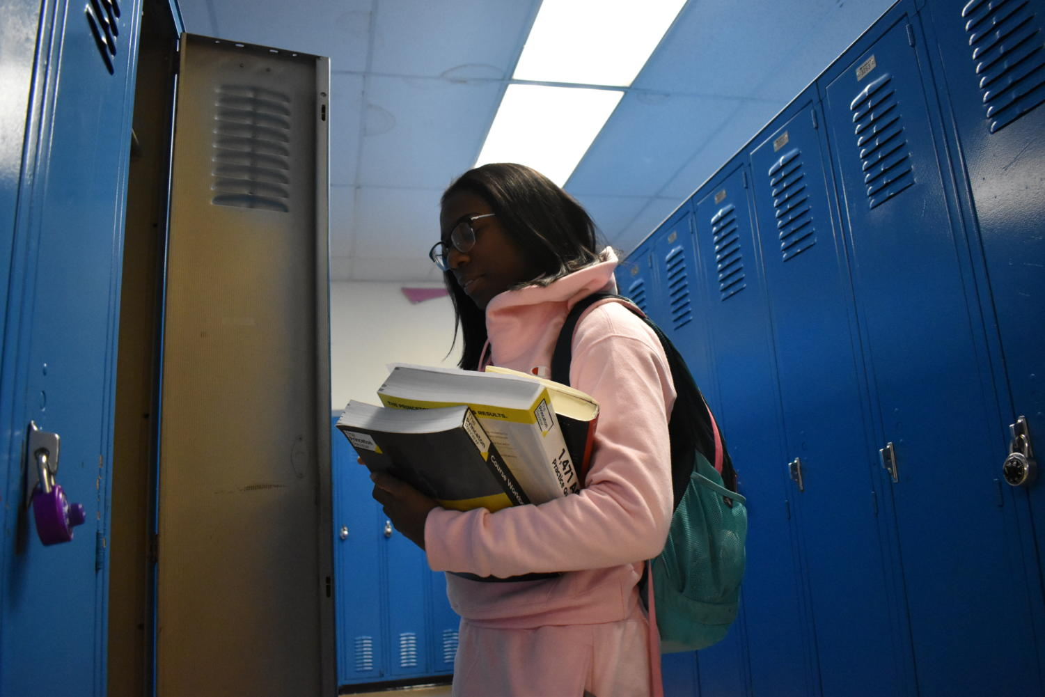 "An assortment of books cradled in her arms, junior Meela Abby arranges belongings in her locker. Abby was enrolled in Parkway from kindergarten, hoping to study psychology upon graduating high school. ""My sister went to school here and she told me that as soon as I come here, I need to start working. With my schedule you can't procrastinate or things go bad,"" Abby said. ""If you want your education, you have to work hard. It doesn't come easy."""