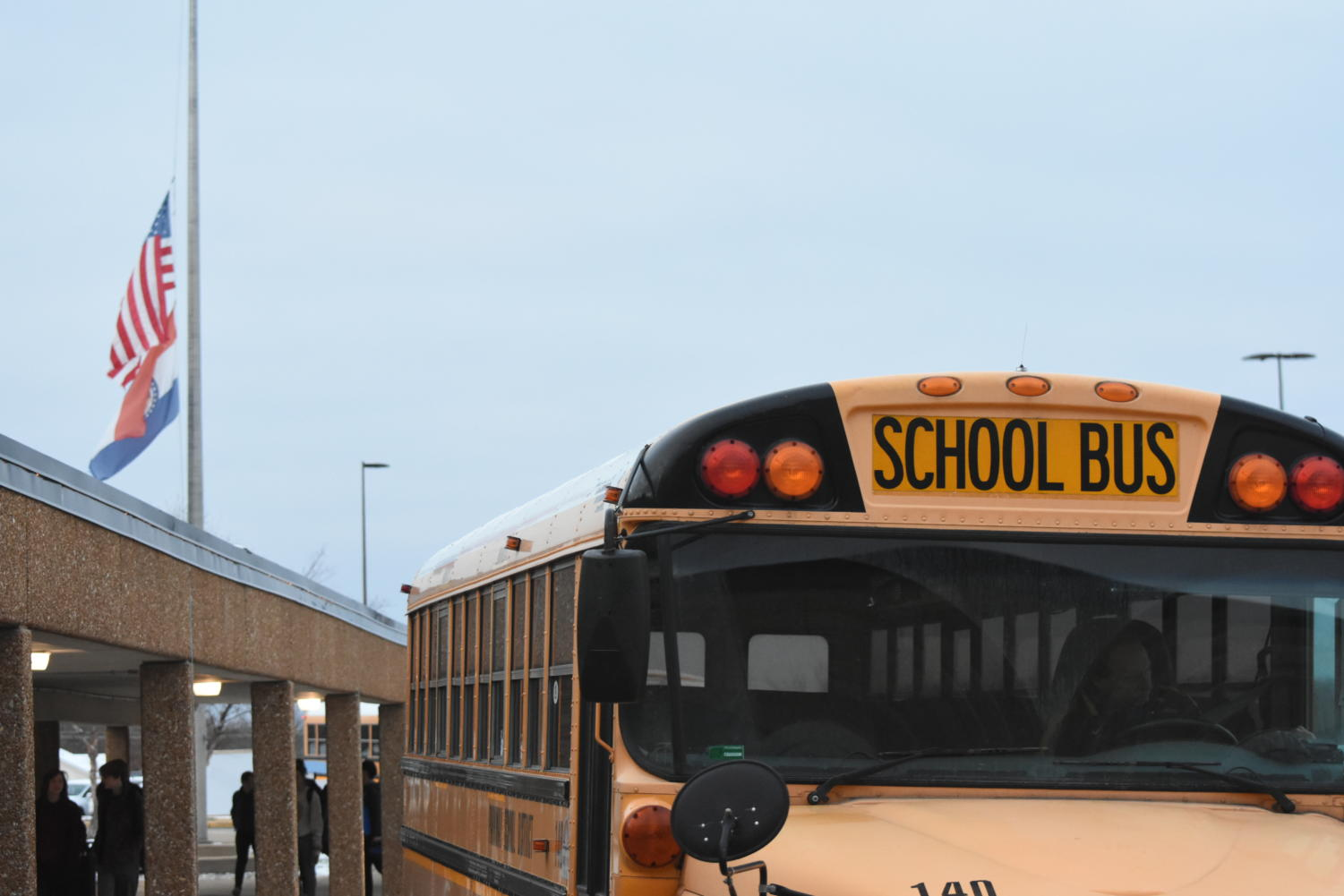A Parkway school bus waits outside the building's front entrance.