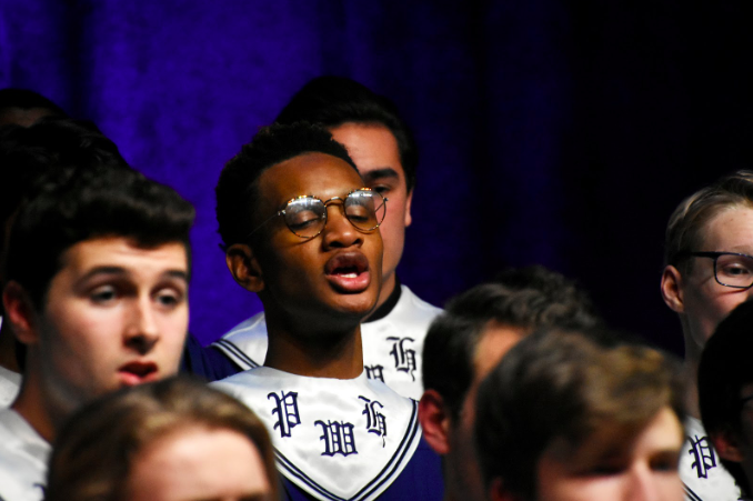 "Singing ""The First Noel,"" senior Malik Penton harmonizes with Concert Choir at the Winter Concert Dec. 11. Students from grades seven through 12 performed at the 50th anniversary of the Winter Concert. ""Being in Concert Choir, after eight years of choir, is one of the most special experiences of life. Wherever I go, I'll always have the memories with my friends to hold onto. When I transferred junior year to Marquette and later Saint Charles West High School, I made sure choir was on my schedule because music is something I can't live without,"" Penton said."