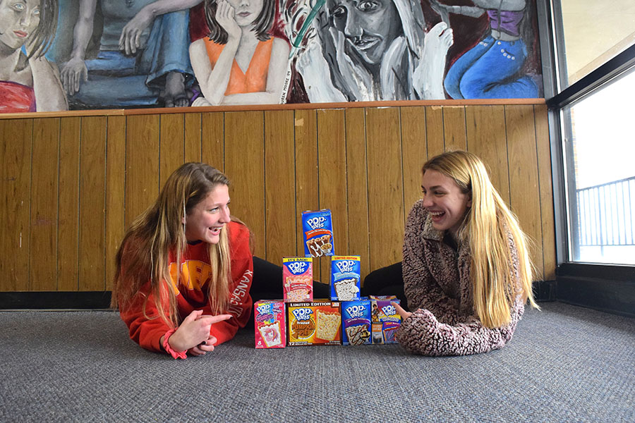 Sophomores Irene Yannakakis and Anna Pavlisin lay in the hallway deciding what Pop Tart flavor to try next.