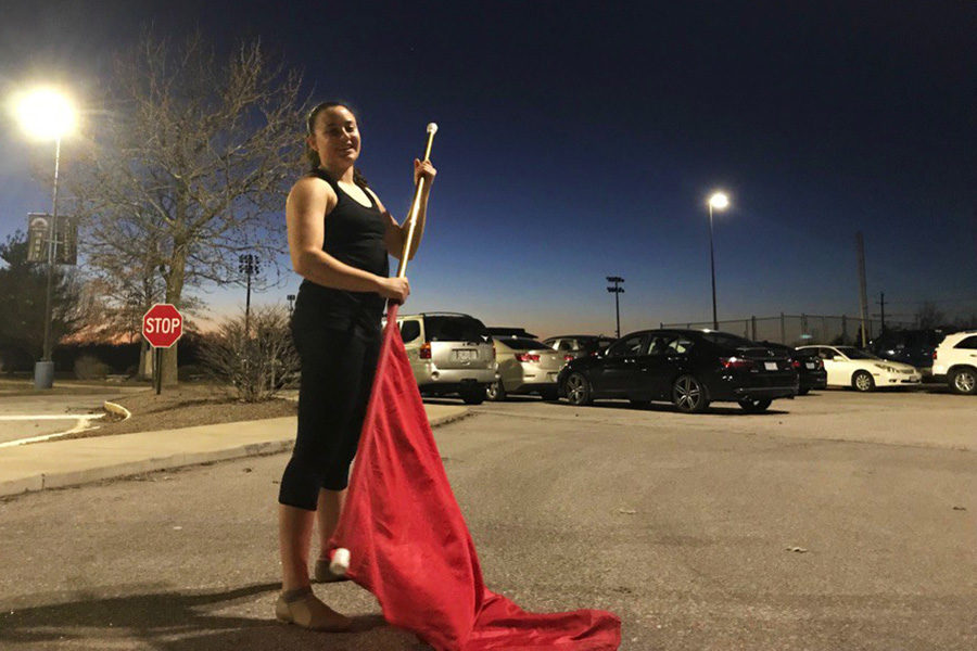 6:13 p.m. Practicing outside during a seven-hour winter guard camp on Jan. 5, senior Alison Clay pauses in between spins. Clay walked away from the day with four bruises, three new tosses and over half of the show learned.