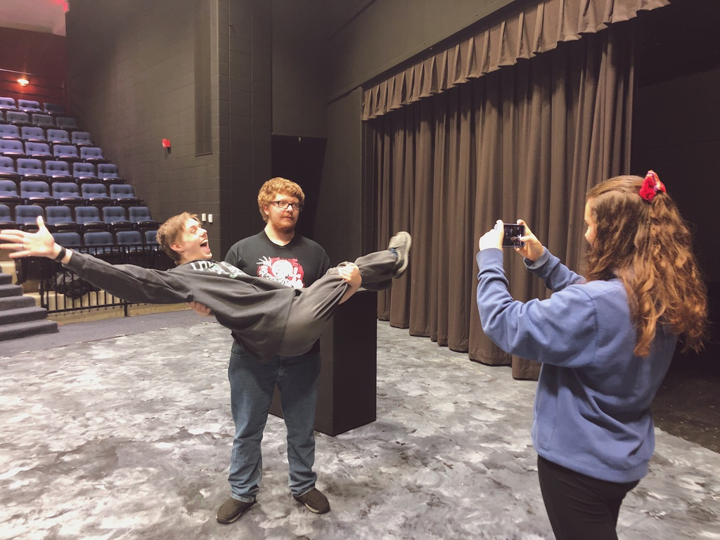 "Gathering clips for their first assignment, seniors MJ Stricker, Matthew Showers and Carson Lolley film in the theatre. Students were tasked with creating a 30 second film inspired by the techniques filmmaker Lev Kuleshov. ""I like having a simple task so I can be more creative in the filmmaking process,"" Lolley said. ""I'm excited to keep working on bigger and better projects throughout the semester."""
