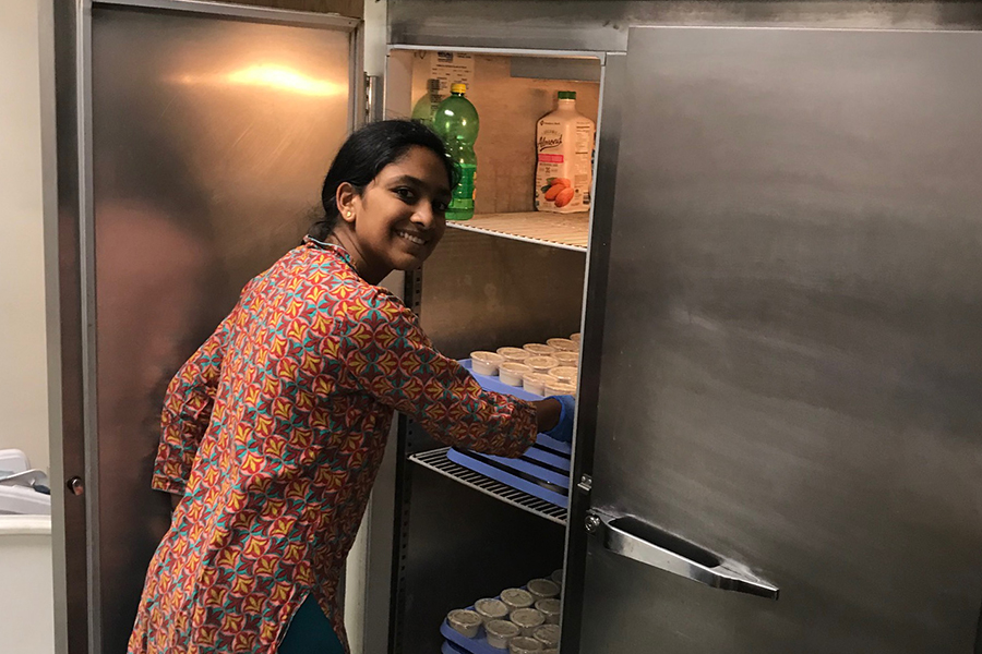 """Stacking condiments in the Hindu Temple of Saint Louis' kitchen, freshman Brinda Ambal volunteers while also gaining a better understanding of her culture and religion. Ambal has been a member of her temple's Youth Group since 2016. """"In St. Louis I can make [Hinduism] my own. The small things aren't that important, it's about how you live your life and follow the religion as a whole,"""" Ambal said. """"A lot of our Holy Texts have stories about courage and trusting yourself so that you are best able to serve others."""""""