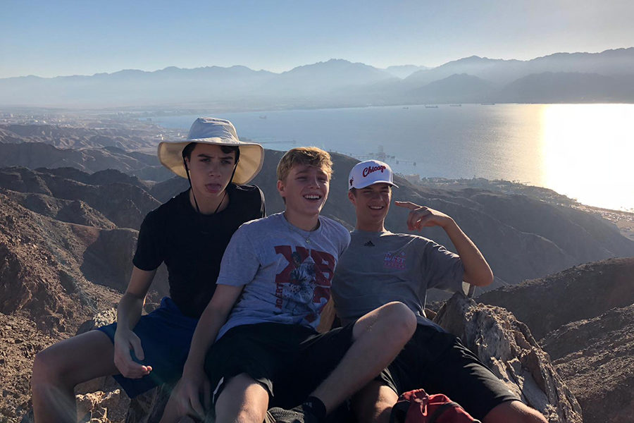 Smiling+with+friends%2C+sophomore+Joe+Rosenberg+participates+in+a+5-day+hike+across+the+Northern+part+of+Israel.+Rosenberg%2C+alongside+other+students+in+the+Heller+High+program%2C+slept+outside+and+self-navigated+for+the+entire+duration+of+their+journey.+%E2%80%9COn+the+last+day%2C+I+happened+to+flip+over+my+bike+and+gash+my+hands+so+I+got+to+ride+in+a+medic+car+all+the+way+to+the+Mediterranean+Sea%2C%E2%80%9D+Rosenberg+said.+