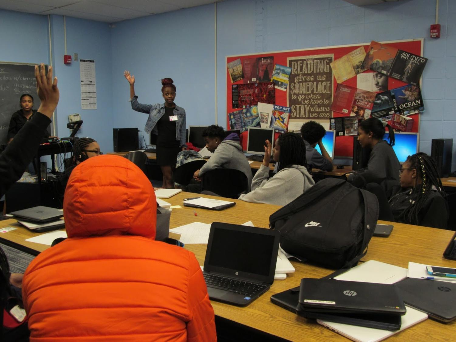 "As students raise their hands, president Kyra Clerk leads a meeting to discuss the positives and negatives of attending a Historically Black College or University (HBCU) or a Predominantly White Institutions (PWI). Students were called out of class during school hours to attend the meetings. ""ASAP empowers me to do better in school but I like to think that I was already doing well,"" Clerk said. ""I feel like it kind of gave me a push to continue being a role model for my underclassmen;  I'm the president so when they look at me, I want them to be able to say, 'My president is studious. She's there for me and she's also very helpful.'"""