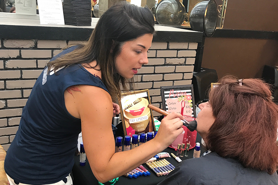 """Spanish teacher Lauren Bernstein promotes SeneGence tinted lotion to potential customers. After this year, Bernstein will be leaving the education field to pursue sales for these cosmetics. """"This really provided an opportunity for me,"""" Bernstein said. """"I do [feel empowered], both on the business sense of things and [the personal]."""""""