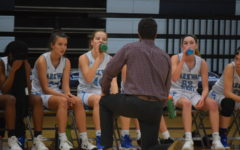 """Coach Josh Gannan goes over the game plan with the girls JV basketball team as they take on Fort Zumwalt North High School. The team lost to the Panthers 23-29. """"Our main goal is to always be improving,"""" Gannan said. """"You never start out your very best, but if you can see little bits of improvement throughout the season, you know you are doing something right. I have been very proud of the girls and their work ethic to turn things around and become better players."""""""