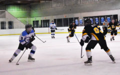 """Sophomore Ty Waddell takes stride into the offensive zone looking to add to their lead against the Lafayette Lancers. The Longhorns lead the game 3-1 in the third period. """"I was just trying to get through the defender and get a good scoring chance and put the puck on net,"""" Waddell said."""