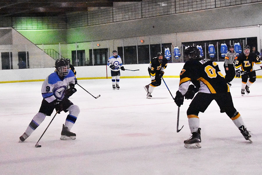 "Sophomore Ty Waddell takes stride into the offensive zone looking to add to their lead against the Lafayette Lancers. The Longhorns lead the game 3-1 in the third period. ""I was just trying to get through the defender and get a good scoring chance and put the puck on net,"" Waddell said."