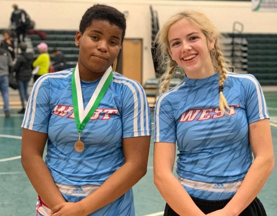 Sophomore Emma Carter and freshman Paige Wehrmeister pose together after the Mehlville Women's Invitational Dec. 21. The tournament was the first girls tournament that either one had been to; Carter took third place in the 167 pound weight class, and Wehrmeister took fifth in the 121 pound weight class.