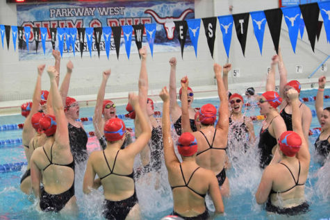 "Leading their team in their final West spell-out cheer, the seniors jump screaming ""Let's go West."" Before every home meet, the girls cheered in the center of the pool.  ""It was a bittersweet feeling. I was sad that things were becoming our 'lasts,' but I was also really grateful for my swim family,"" senior Natalie Butler said."