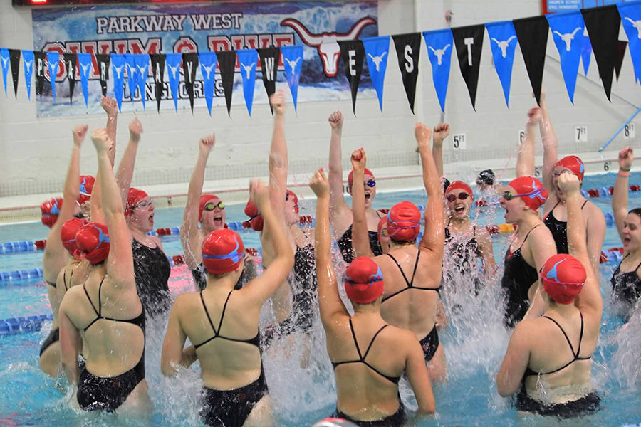 """Leading their team in their final West spell-out cheer, the seniors jump screaming """"Let's go West."""" Before every home meet, the girls cheered in the center of the pool.  """"It was a bittersweet feeling. I was sad that things were becoming our 'lasts,' but I was also really grateful for my swim family,"""" senior Natalie Butler said."""