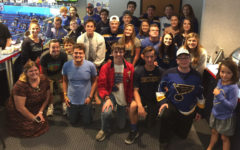 "Kelly Quinn, standing to the left, poses with Best Buddies at a Pre-Season St. Louis Blues game hosted by St. Louis Blues Alumni. This opportunity helped members of Best Buddies strengthen their friendships through a shared passion for hockey. ""[I love] witnessing two people click as friends,"" Quinn said. ""It is like watching magic or seeing someone truly come to life. The joy from seeing others feel joy is extremely powerful."""