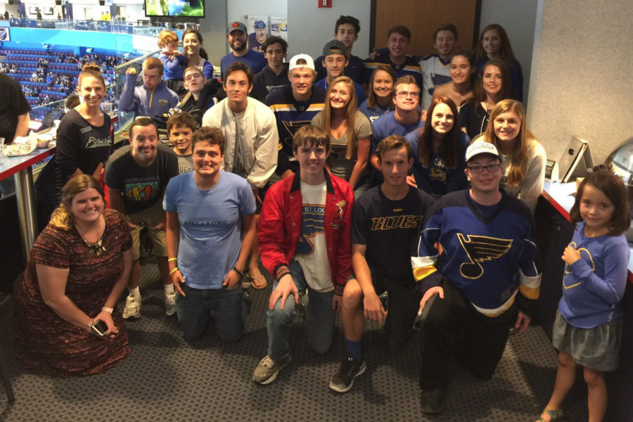 Kelly+Quinn%2C+standing+to+the+left%2C+poses+with+Best+Buddies+at+a+Pre-Season+St.+Louis+Blues+game+hosted+by+St.+Louis+Blues+Alumni.+This+opportunity+helped+members+of+Best+Buddies+strengthen+their+friendships+through+a+shared+passion+for+hockey.+%E2%80%9C%5BI+love%5D+witnessing+two+people+click+as+friends%2C%E2%80%9D+Quinn+said.+%E2%80%9CIt+is+like+watching+magic+or+seeing+someone+truly+come+to+life.+The+joy+from+seeing+others+feel+joy+is+extremely+powerful.%E2%80%9D