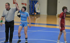 "Hand raised after her first pin of a male opponent, Wehrmeister grins at her triumph. ""I feel like I am in control of them [when I'm on top], and if I wanted to I could control everything that was happening in that moment,"" Wehrmeister said. ""They can't get up if I don't let go."""