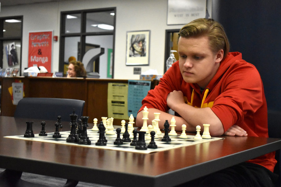 Focusing+in+on+a+new+strategy+to+beat+future+opponents+in+an+upcoming+tournament%2C+chess+team+captain+and+senior+Matt+Boyd+draws+on+his+self-made+improvements+to+strategically+think+through+his+moves.+Earlier+in+his+career%2C+Boyd+made+moves+quicker+than+he+does+now%3B+however%2C+he+has+improved+as+a+player+and+realized+the+importance+of+working+through+the+scenarios.+%E2%80%9CWe+have+had+multiple+matches+where+I+spent+all+of+my+two+hours%2C+and+I%27m+the+last+one+there%2C%E2%80%9D+Boyd+said.+%E2%80%9CI%27m+just+so+involved+%5Bin+the+game%5D.+I+don%27t+think+there%27s+any+one+thing+that+makes+me+concentrate+more+than+other+people%2C+but+I+guess+it%27s+just+that+I%27m+so+invested+in+it.%E2%80%9D