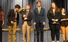 "During the awards ceremony of the 2019 Missouri State High School Activities Association (MSHSAA) Speech and Debate tournament, seniors Luke Donovan and Kristina Humphrey await their names to be announced with their placement. Donavon and Humphrey qualified for state in the duet event and placed second overall in the tournament. ""I stayed in speech and debate [for four years] because the team and people from other teams in the district are like my second family. While competition can be brutal, it's worth it to be with the amazing people in Eastern Missouri,"" Humphrey said. ""Speech has made me grow as a person significantly. It has given me the opportunity to spread important messages through unique ways of conveying them."" Photo by Fatema Rehmani."