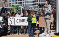 """Senior Noah Wright delivers a speech at the St. Louis Youth Climate Strike US in front of a crowd of 100. Wright was a lead organizer for the event after being inspired by what he learned in AP Environmental Science and Honors Environmental Sustainability. """"For decades, our politicians have failed us by doing so little when we need so much. It is my hope they see crowds like this across the country and realize that the time for denial is over,"""" Wright said. """"To our politicians we have one message: take action against climate change or we will vote you out."""""""