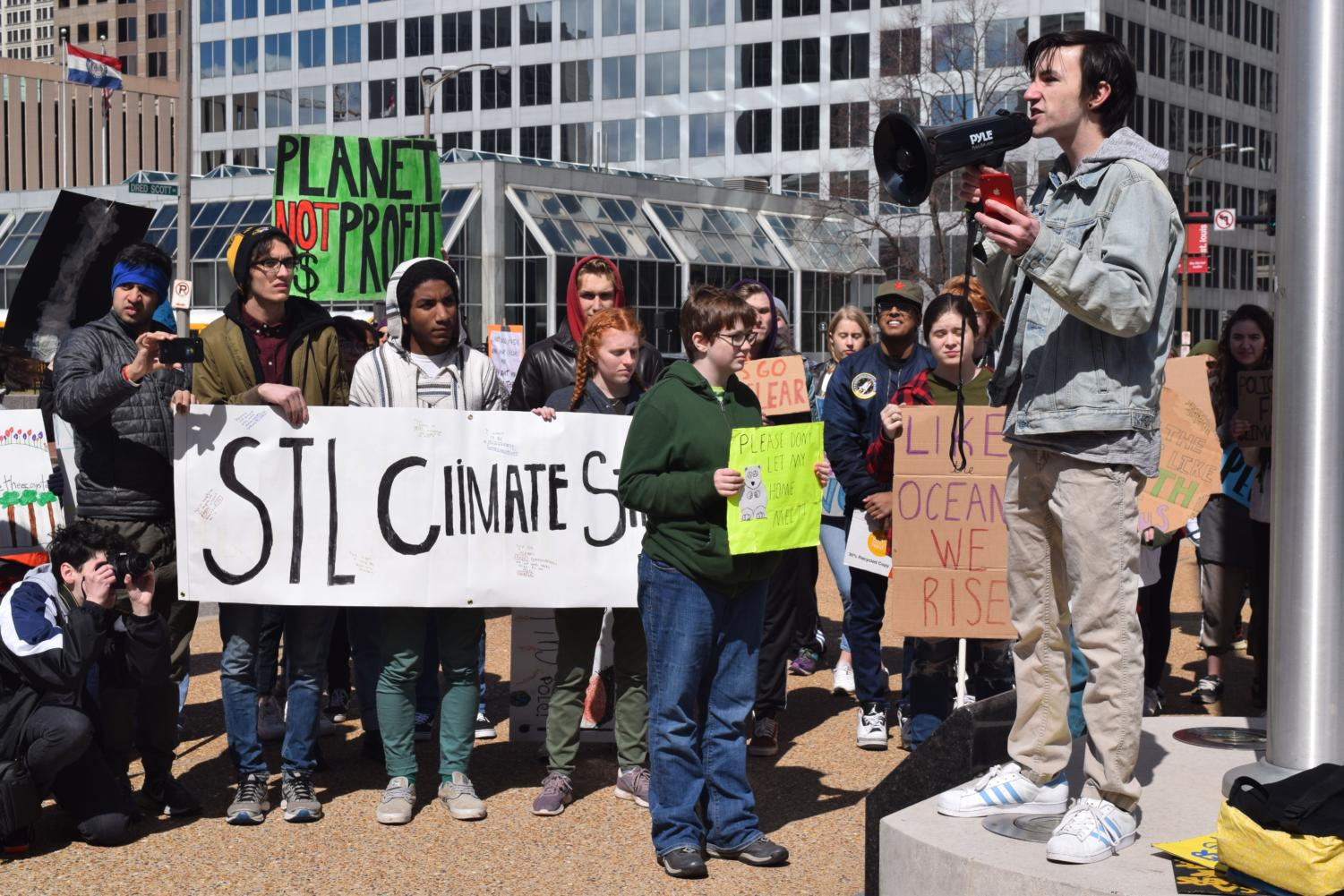 "Senior Noah Wright delivers a speech at the St. Louis Youth Climate Strike US in front of a crowd of 100. Wright was a lead organizer for the event after being inspired by what he learned in AP Environmental Science and Honors Environmental Sustainability. ""For decades, our politicians have failed us by doing so little when we need so much. It is my hope they see crowds like this across the country and realize that the time for denial is over,"" Wright said. ""To our politicians we have one message: take action against climate change or we will vote you out."""