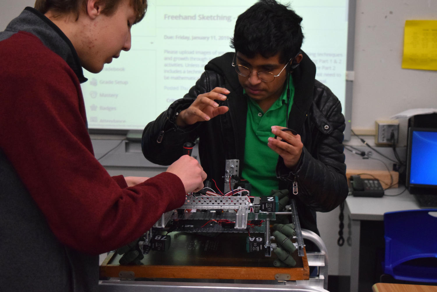 """Attending a meeting after school, sophomore Kunal Addagarla makes adjustments to their robot. Twisted Metal was not able to qualify for the 2019 Missouri State VEX Championship, but they will be newcomers at the CREATE US Open Robotics Championship displaying teams from across the U.S. and China. """"I would say teamwork is very important because we have different roles to fulfill,"""