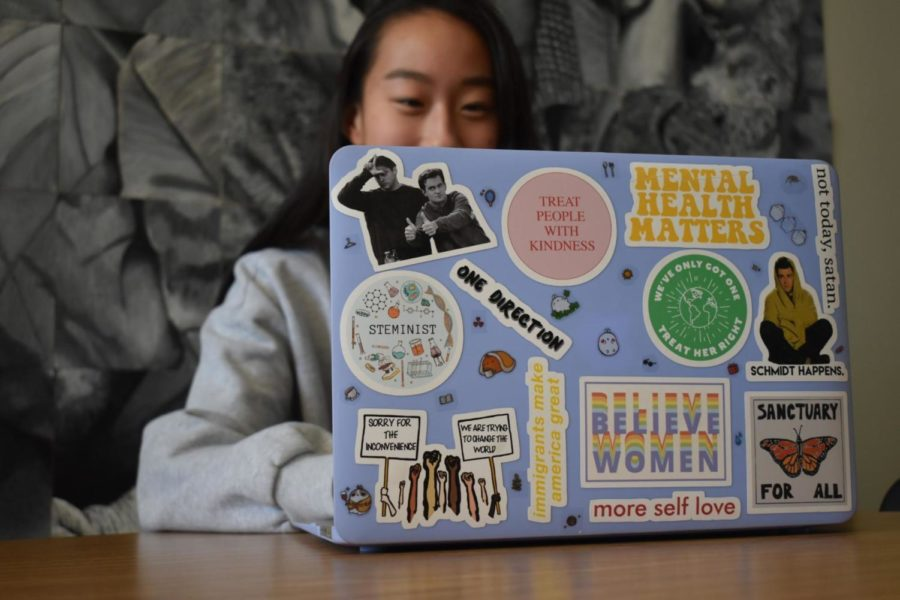 During+second+lunch%2C+junior+Angie+Jia+works+on+homework.+As+the+daughter+of+immigrants%2C+Jia+cares+for+issues+surrounding+civil+liberties+and+social+causes+and+chose+laptop+stickers+that+would+represent+her+passions.+%E2%80%9CMy+%E2%80%98Immigrants+Make+America+Great%E2%80%99+represents+my+parents%2C+who+I+am+and+who+I+feel+should+be+empowered+in+America%3A+immigrants.+I+value+protecting+and+preserving+our+environment+over+industry+so+I+have+an+environmental+awareness+sticker+too%2C%E2%80%9D+Jia+said.+%E2%80%9CMy+%E2%80%98Believe+Women%27+sticker+I+got+around+the+time+of+the+Brett+Kavanaugh+hearings+because+I+strongly+agreed+with+what+Dr.+Christine+Blasely+Ford+was+doing+by+empowering+women+and+believing+their+stories.%E2%80%9D