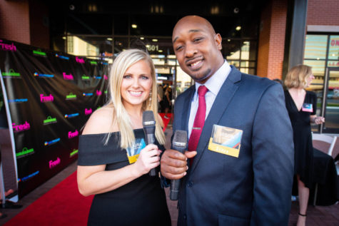 "Laura Kleffner stands on the red carpet with coworker Jason Watson at the annual Mission: St. Louis Night for the Town Gala in September 2018. Kleffner and Watson were emcees for this event that raised $450,000. ""Professionally, [this was] one of my greatest accomplishments at Mission: St. Louis,"" Kleffner said. ""[I am] constantly [wanting to] expand the awareness [about Mission: St. Louis] but also raise more money through different avenues."""