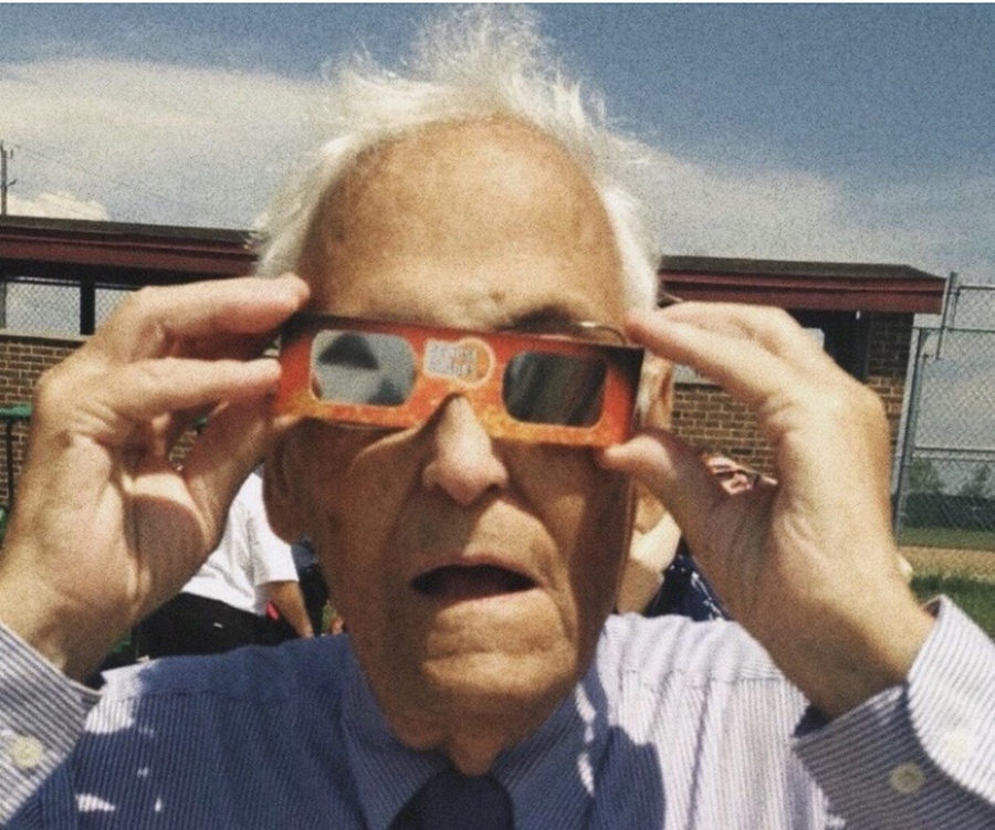 "Wearing special glasses, Schepp views the solar eclipse Aug. 21, 2017. An electrical engineer for McDonnell Douglas during the Mercury Project, Schepp loved space. ""Mr. Schepp never had a dull moment. He was a ray of sunshine,"" junior Umeera Farooq said."