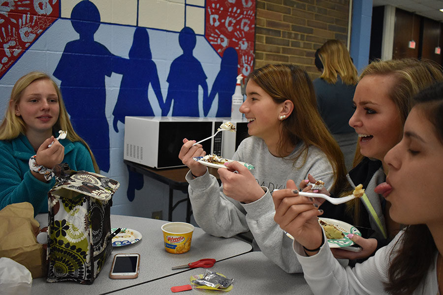 On+Pi+Day%2C+March+14%2C+juniors+Emily+Weaver%2C+Emily+Lofgren%2C+Lauren+Adam+and+Katie+Mendonsa+support+Mu+Alpha+Theta%E2%80%99s+Pi+day+fundraiser+by+purchasing+and+eating+slices+of+%E2%80%9CPi%E2%80%9D.+Mu+Alpha+Theta+sold+109+pies+for+%242+per+slice%2C+the+proceeds+will+go+toward+the+math+department+for+new+desks%2C+subsidizing+math+contest+fees+and+new+calculators.+%E2%80%9CEating+pie+is+a+fun+way+for+kids+to+get+involved+with+math+activities+that+they+normally+couldn%27t+participate+in+on+other+days%2C%E2%80%9D+Lofgren+said.+