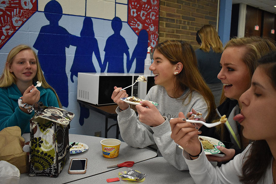 "On Pi Day, March 14, juniors Emily Weaver, Emily Lofgren, Lauren Adam and Katie Mendonsa support Mu Alpha Theta's Pi day fundraiser by purchasing and eating slices of ""Pi"". Mu Alpha Theta sold 109 pies for $2 per slice, the proceeds will go toward the math department for new desks, subsidizing math contest fees and new calculators. ""Eating pie is a fun way for kids to get involved with math activities that they normally couldn't participate in on other days,"" Lofgren said."