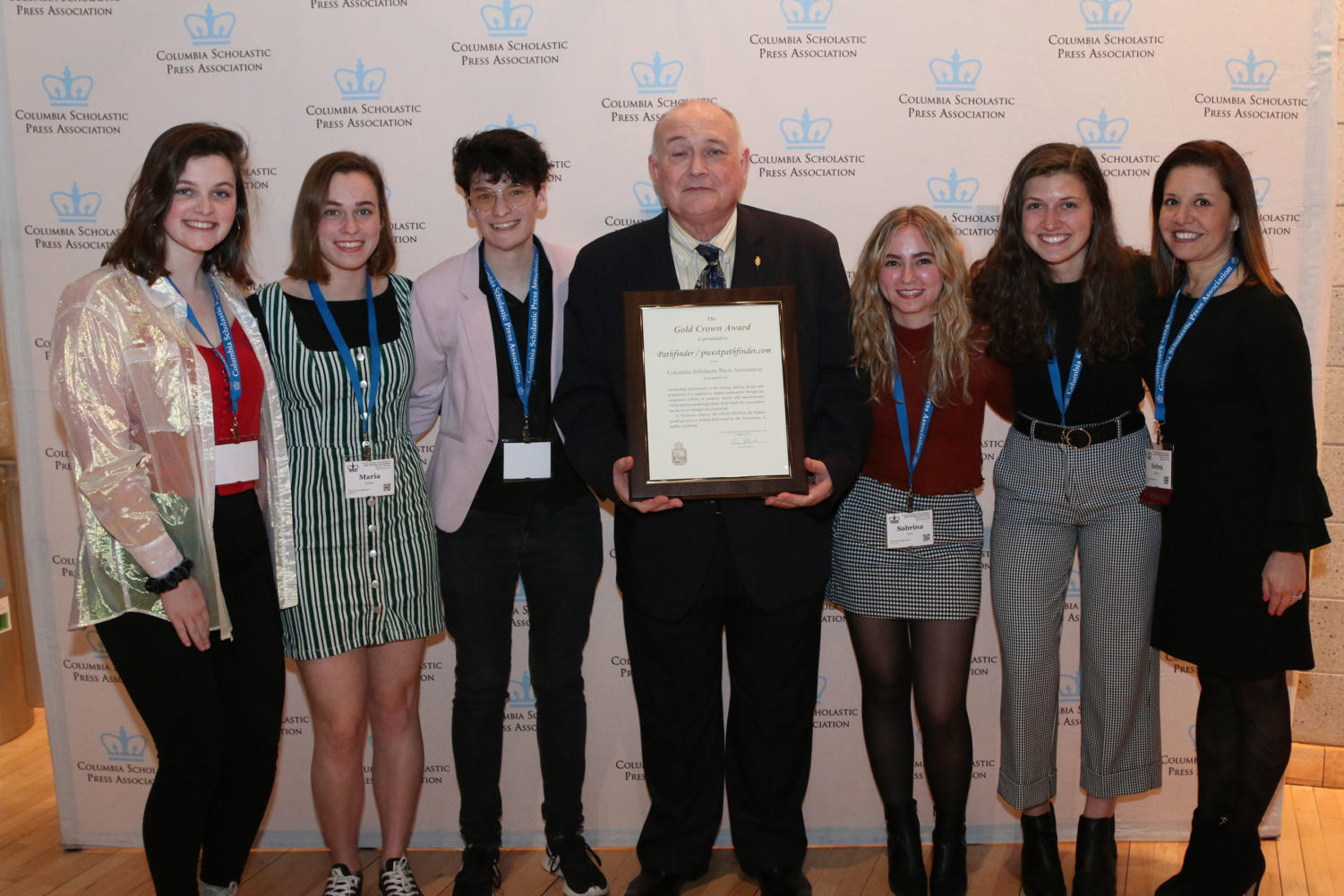"Pathfinder editors junior Lydia Roseman, seniors Maria Newton and Dani Fischer and juniors Sabrina Bohn and Emma Caplinger, along with Journalism Adviser Debra Klevens take a photo with Edmund J. Sullivan, the Executive Director of the Columbia Scholastic Press Association, after receiving a Gold Crown award. In 2018, the Pathfinder won a CSPA Silver Crown Award. ""It was an incredible experience to be in a room with so many of the schools that we look up to and draw inspiration from,"" senior and Managing Editor-in-Chief Dani Fischer said."