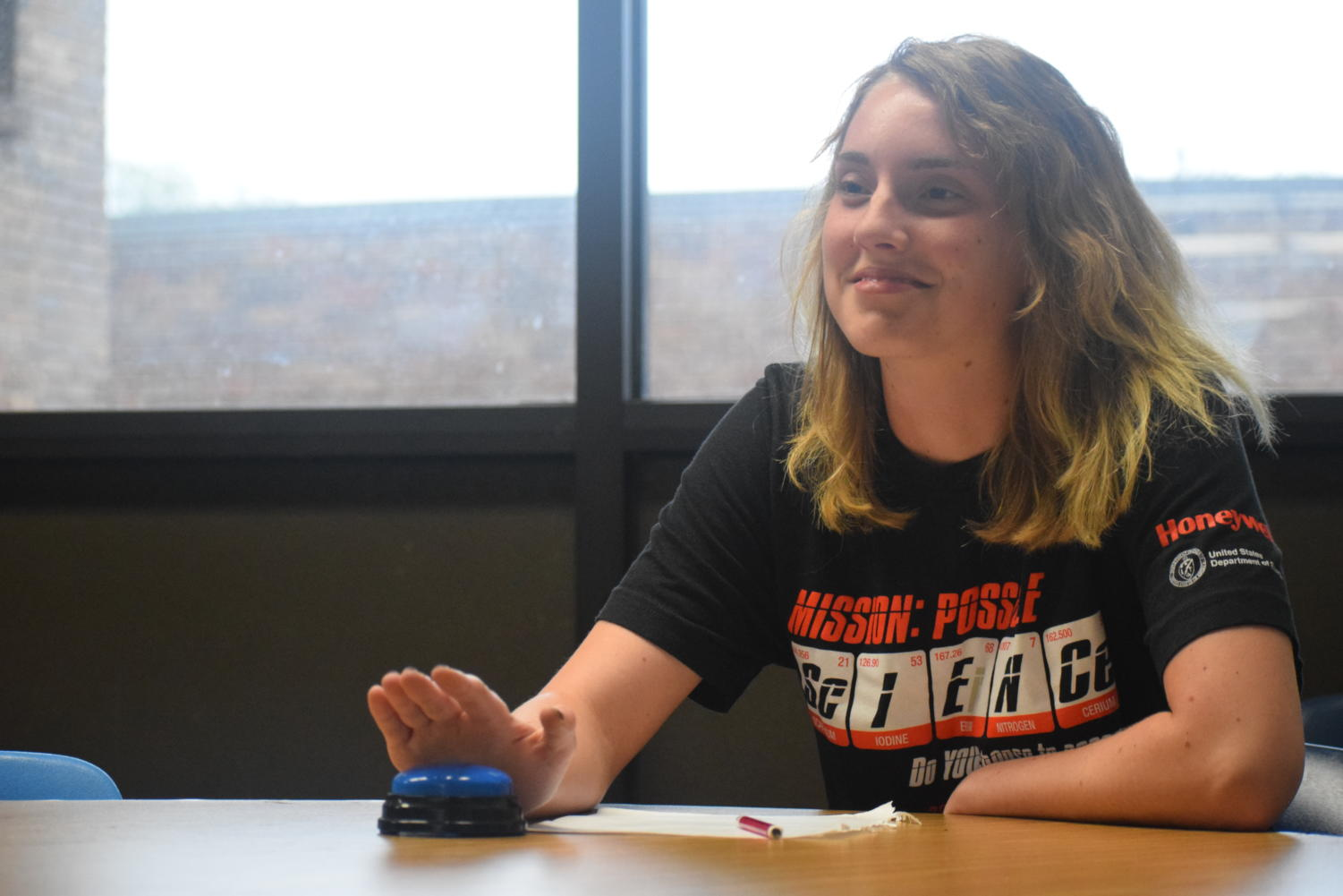 """With her right hand hovering over the buzzer, senior Lindsay Perrett answers questions in the science bowl. The team answered questions that concerned all branches of math and science. """"It was an exciting event for me to be a part of, and it benefitted me academically too,"""" Perrett said."""